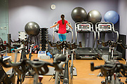 A women running on a treadmill machine surrounded by swiss balls, hand weights and other exercise equipment in a gym in London, England, United Kingdom. (photo by Andrew Aitchison / In pictures via Getty Images)