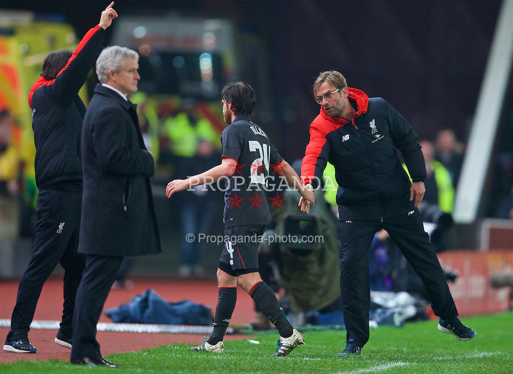 STOKE-ON-TRENT, ENGLAND - Tuesday, January 5, 2016: Liverpool's manager Jürgen Klopp shakes hands with Joe Allen after substituting him against Stoke City during the Football League Cup Semi-Final 1st Leg match at the Britannia Stadium. (Pic by David Rawcliffe/Propaganda)