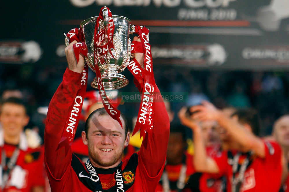 File photo dated 28-02-2010 of Manchester United's Wayne Rooney lifts the Carling Cup trophy