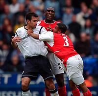 Photo. Richard Lane<br />Bolton Wanderers v Arsenal. Barclaycard Premiership 26/04/2003.<br />Ashley Cole reacts badly to a challenge from Salva Ballesta.