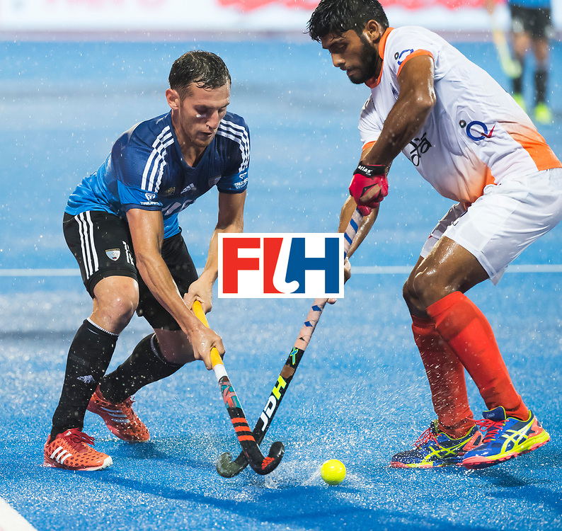 BHUBANESWAR -  Hockey World League finals , Semi Final . Argentina v India. Lucas Vila (Arg) with Varun Kumar (Ind)   COPYRIGHT KOEN SUYK