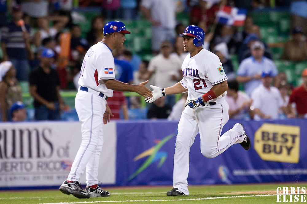 8 March 2009: #21 Miguel Olivio of Dominican Republic celebrates with third base coach Luis Silverio as he runs the base after his homerun during the 2009 World Baseball Classic Pool D match at Hiram Bithorn Stadium in San Juan, Puerto Rico. Dominican Republic wins 9-0 over Panama.