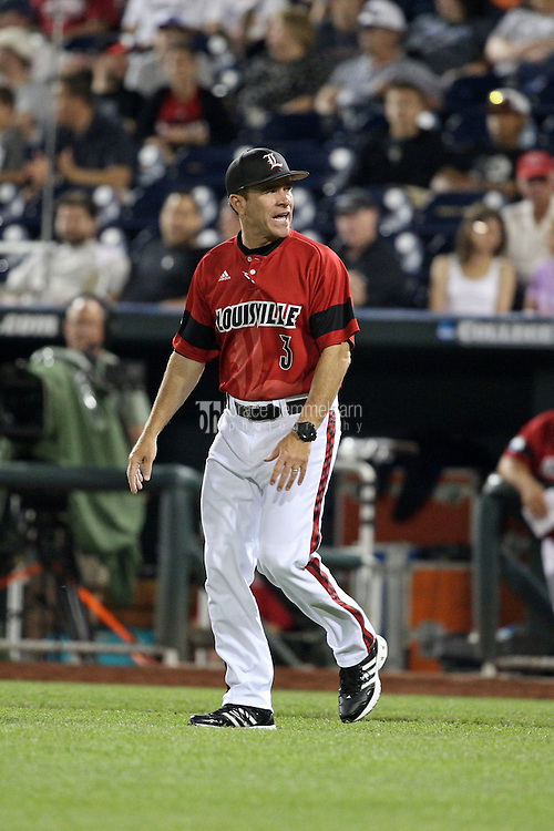 Head coach Dan McDonnell of the Louisville Cardinals looks on during Game 2 of the 2014 Men's College World Series between the Vanderbilt Commodores and Louisville Cardinals at TD Ameritrade Park on June 14, 2014 in Omaha, Nebraska. (Brace Hemmelgarn)