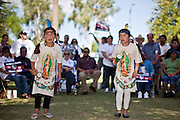 "June 13 - PHOENIX, AZ: CAMILA FRANCO, 7, (left) and her sister, KARITIA FRANCO, 8, from Glendale, AZ, perform a dance honoring the Virgin of Guadalupe during an immigrants' rights rally and vigil at the Arizona State Capitol in Phoenix Sunday. About 40 immigrants' rights activists from Anaheim, California, joined Phoenix area activists at the Arizona State Capitol Sunday for a prayer vigil and rally against SB 1070, the Arizona law that gives local law enforcement agencies the power to ask to see proof of immigration status in the course of a ""lawful contact"" and when ""practicable."" Immigrants' rights and civil rights activist say the bill will lead to racial profile. Proponents of the bill say it is the toughest local anti-immigration bill in the country and merely brings state law into line with federal immigration law.  The law, which was signed by the Arizona Governor in April, goes into effect on July 29, 2010.   Photo by Jack Kurtz"
