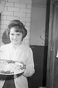 Bord Iascaigh Mhara Fish cookery competition, Enniscorthy Vocational School, Co. Wexford.  Mary Bates (15), Bridgetown Vocational Schools, who won the Wexford County Final.<br /> 30.01.1964