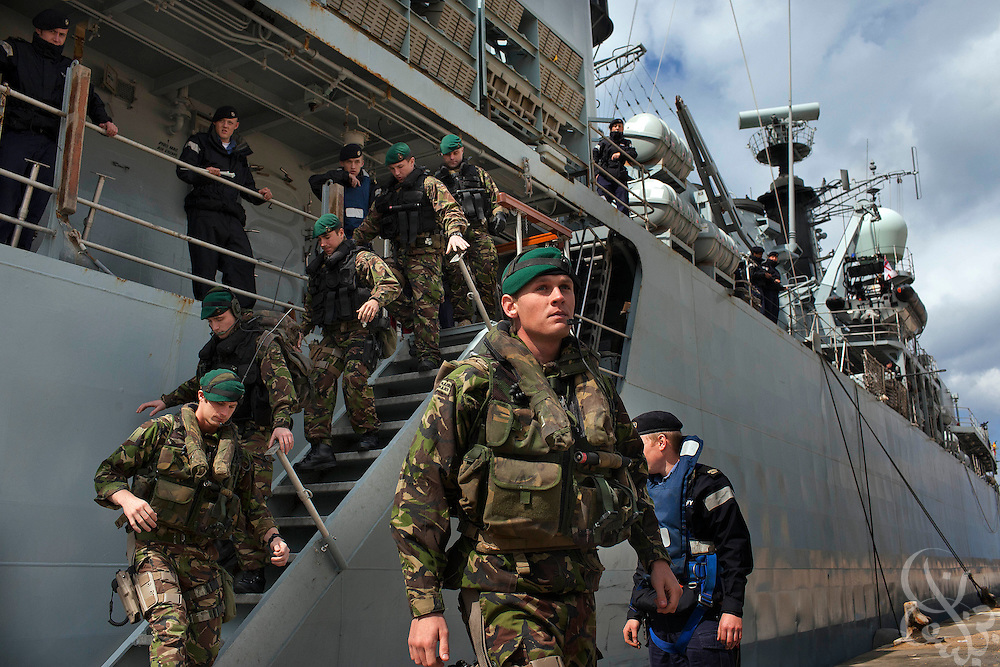 UK Royal Marines disembark from the British Royal Navy frigate HMS Cumberland to provide security during an evacuation mission of UK, EU and United States citizens February 27, 2011in Benghazi, Libya. Most Western countries have closed their embassies in Libya, and have advised citizens that they should leave the country while they still can..Slug: Libya.Credit: Scott Nelson for the New York Times