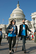 Attendees walk past the Capitol  during the National Brain Tumor Society Head to the Hill day on Capitol Hill in Washington, DC on May 8, 2018. (Photo by Alan Lessig_