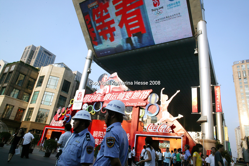 BEIJING, AUGUST 5 :  public security guards patrol one of the places where Beijingers can watch live broadcasts of the Olympic Games.