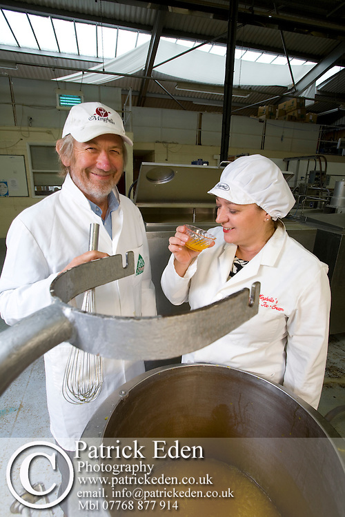 Husband Richard, Gioia Minghella, Tasting ice cream, Minghella Ice Cream, Production Facility, Wooton, Isle of Wight, England, UK, Photographs of the Isle of Wight by photographer Patrick Eden photography photograph canvas canvases