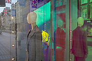 With a further 184 reported UK Covid deaths in the last 24 hrs, a total now of 43,414, retail mannequins in the window of the Armani store on New Bond Street are seen with, in the background, Union Jack flags and the thank you banners that support NHS key workers during the Covid pandemnic lockdown, now easing after three months of the Stay At Home policy but now being relaxed as the shops re-open, on 26th June 2020, in London, England. Government restrictions on the 2 metre rule is to be realxed on 4th July and replaced with 'one metre plus' in the hope it stimulates the struggling UK economy.