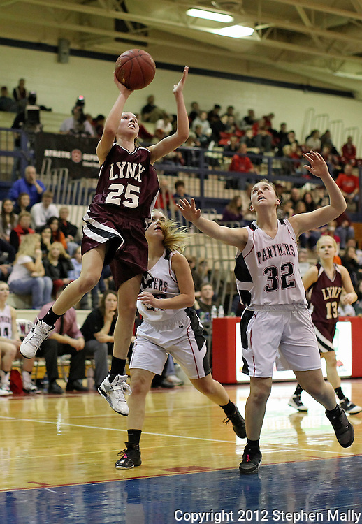 North-Linn's Nicole Miller (25) puts up a shot past Monticello's Taylor Aitchison (20) and Paxtyn Keleher (32) during their Rivalry Saturday game at Washington High School at 2205 Forest Drive SE in Cedar Rapids on Saturday, January 21, 2012. (Stephen Mally/Freelance)