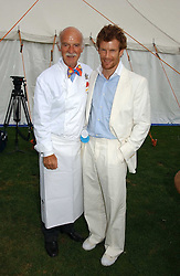 Left to right, chefs ANTON MOSIMANN and TOM AIKENS  at the Cartier International polo at Guards Polo Club, Windsor Great Park, on 30th July 2006.<br />