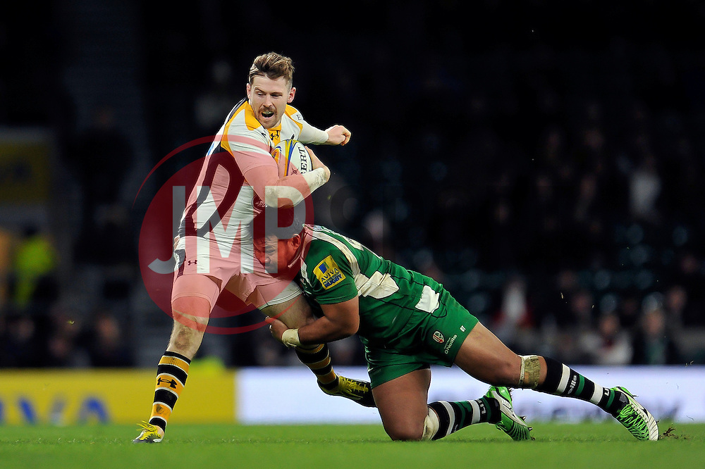 Elliot Daly of Wasps is tackled by Ofisa Treviranus of London Irish - Mandatory byline: Patrick Khachfe/JMP - 07966 386802 - 28/11/2015 - RUGBY UNION - Twickenham Stadium - London, England - London Irish v Wasps - Aviva Premiership.