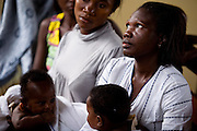 Women and their children waiting at the Osu Maternity Home in Accra, Ghana on Tuesday June 16, 2009.