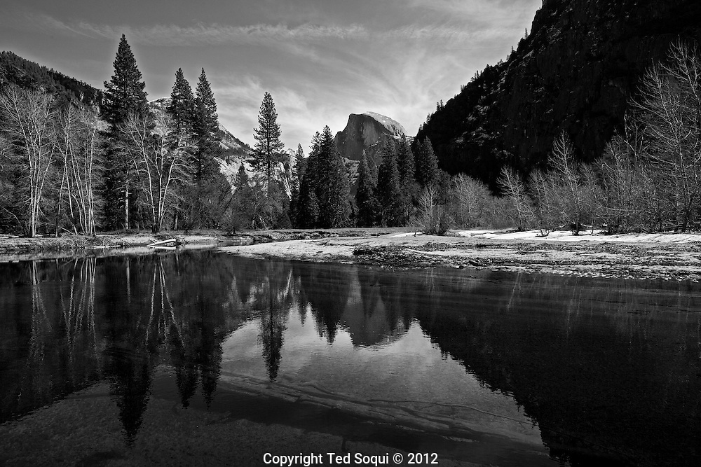 Half Dome reflects in the Merced River.