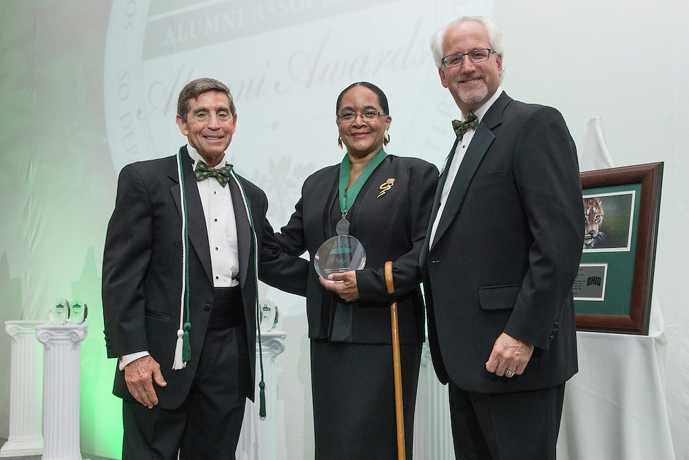 From Left, Larry Starr, Deborah McDavis and Ron Teplitzky pose after McDavis was awarded the Honorary Alumna during the 2016 Alumni Awards Gala at Ohio University's Baker Center Ballroom on Friday, October 07, 2016.