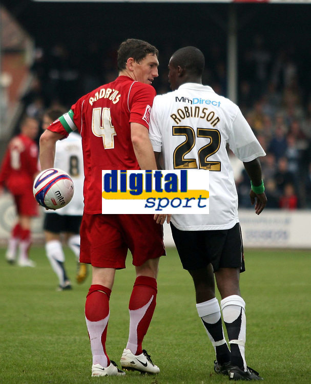 Photo: Mark Stephenson.<br /> Hereford United v Milton Keynes Dons. Coca Cola League 2. 20/10/2007.M K Dons Bally Smart has words with Hereford's Theo Robinson