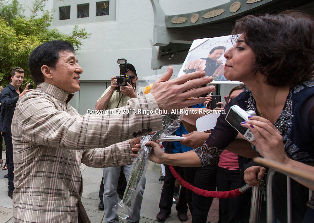 Actor Jackie Chan greets with fans after his hand and footprint ceremony in front of the TLC Chinese Theatre in Hollywood, California on June 6,2013. Chan became the first ever Chinese star immortalized in cement in Hollywood. (Photo by Ringo Chiu/PHOTOFORMULA.com)