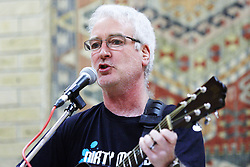 "© Licensed to London News Pictures.  17/12/2011. Buckinghamshire, UK. Martin Davis (pictured), lead singer of band Dirty Mavis performs The Oak Tree Lament (Did you stop the HS2), at the Stop HS2 Christmas party in Lacey Green. The protest song against the planned high speed railway between London and Birmingham that would devastate the Chilterns mocks the £17 billion cost as ""a pound for every leaf"".  Martin, a footwear designer and salesmen, wrote the song in under an hour while commuting to work. The single is due to be released tomorrow (Mon 19th) in time for Christmas and bookmakers have quoted odds as low as 16-1 on it being Christmas #1. Half of the proceeds will go towards the Stop HS2 campaign. Photo credit: Cliff Hide/LNP"