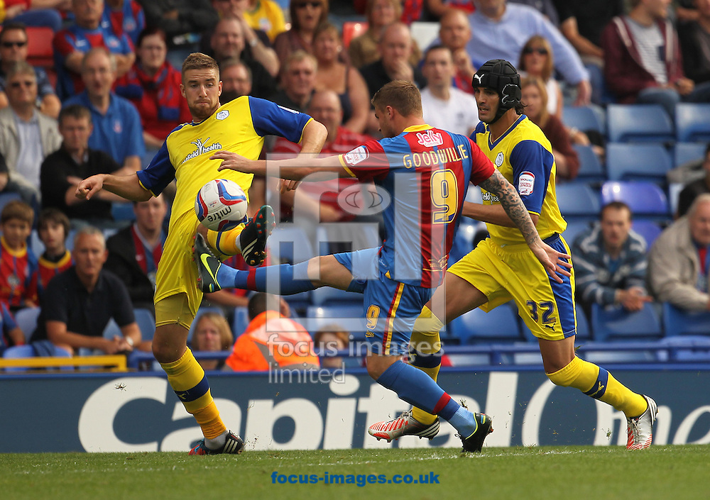 Picture by Daniel Weir/Focus Images Ltd +44 7982 911743.01/09/2012.David Goodwilliw of Crystal Palace takes a shot whilst being closed own by Miguel Llera and Mark Beevers of Sheffield Wednesday during the npower Championship match at Selhurst Park, London.