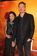 """PARIS, FRANCE - NOVEMBER 22: Michelle Yeoh and David Thewlis attend """"The Lady"""" Premiere at the Gaumont Capucines Theater on November 22, 2011 in Paris.(Photo by Tony Barson/BARSONIMAGES)"""