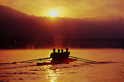 "The sun casts a golden glow through the mist over early morning rowers on West Virginia's Kanawha River. - To license this image, click on the shopping cart below - -- Determine pricing and license this image, simply by clicking ""Add To Cart"" below --"
