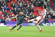Maxim Choupo-Moting tries to block Kyle Waker's pass forward during the Premier League match between Stoke City and Manchester City at the Bet365 Stadium, Stoke-on-Trent, England on 12 March 2018. Picture by Graham Holt.