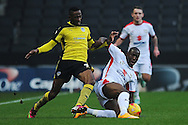 Sanchez Watt of Colchester United looks to get past Benik Afobe of MK Dons during the Sky Bet League 1 match between Milton Keynes Dons and Colchester United at stadium:mk, Milton Keynes<br /> Picture by Richard Blaxall/Focus Images Ltd +44 7853 364624<br /> 29/11/2014
