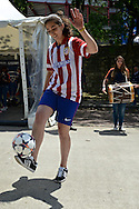 General view of the exterior of the stadium showing a freestyle soccer player entertaining fans pictured ahead of the UEFA Champions League Final at Estádio da Luz, Lisbon<br /> Picture by Ian Wadkins/Focus Images Ltd +44 7877 568959<br /> 24/05/2014