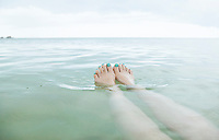 Woman floating in tropical waters in the Gulf of Thailand&#xA;<br />