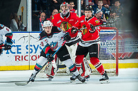 KELOWNA, BC - FEBRUARY 7: Ethan Ernst #19 of the Kelowna Rockets looks for the pass while Johnny Ludvig #15 checks him in front of the net of Joel Hofer #30 of the Portland Winterhawks at Prospera Place on February 7, 2020 in Kelowna, Canada. Hofer was selected in the 2018 NHL entry draft by the ST. Louis Blues. Ludvig was selected in the 2019 NHL entry draft by the Florida Panthers. (Photo by Marissa Baecker/Shoot the Breeze)