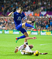 SWANSEA, WALES - Sunday, December 22, 2013: Everton's Kevin Mirallas in action against Swansea City's captain Ashley Williams during the Premiership match at the Liberty Stadium. (Pic by David Rawcliffe/Propaganda)