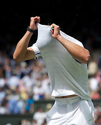 LONDON, ENGLAND - Monday, June 20, 2011: Rafael Nadal (ESP) takes his shirt off during the Gentlemen's Singles 1st Round match on during day one of the Wimbledon Lawn Tennis Championships at the All England Lawn Tennis and Croquet Club. (Pic by David Rawcliffe/Propaganda)