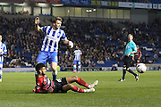Dale Stephens and Oscar Gobern during the Sky Bet Championship match between Brighton and Hove Albion and Huddersfield Town at the American Express Community Stadium, Brighton and Hove, England on 14 April 2015. Photo by Stuart Butcher.