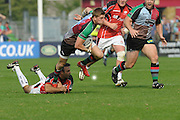Twickenham, GREAT BRITAIN,  Harlequins' David STRETTLE, slips, Neil DE KLOK's tackle during the Harlequins vs Saracens game at The Stoop Stadium, Surrey on Sat. 19.09.2009.  [Photo. Peter Spurrier/Intersport-images]