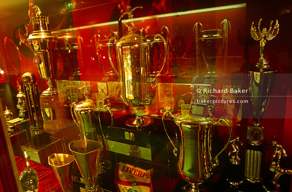 Cups and prizes in the trophy room at Anfield, the sacred home to Liverpool Football Club. Liverpool Football Club is an English Premier League football club based in Liverpool, Merseyside. Liverpool has won eighteen League titles, second most in English football, seven FA Cups and a record seven League Cups. Liverpool has won more European titles than any other English club, with five European Cups, three UEFA Cups and three Super Cups. Liverpool was founded in 1892 and admitted into the Football League the following year. The club has played at its home ground, Anfield, since its founding.