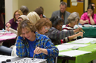Middletown, N.Y. - People try their hand at calligraphy during a Master Class by artist Ron Gee at SUNY Orange on Nov. 14, 2013.