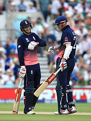 England's Alex Hales celebrates reaching 50 with teammate Joe Root (left) during the ICC Champions Trophy, Group A match at The Oval, London.