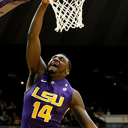 November 12, 2011; Baton Rouge, LA; LSU Tigers forward Jalen Courtney (14) dunks against the Nicholls State Colonels during the second half of a game at the Pete Maravich Assembly Center. LSU defeated Nicholls State 96-74.  Mandatory Credit: Derick E. Hingle-US PRESSWIRE