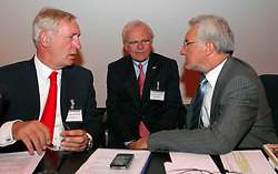 BRUSSELS, BELGIUM - AUGUST-6-2007 - Fortis Chief Executive Officer, Jean-Paul Votron, Chief Financial Officer, Gilbert Mittler and Executive Member of the Fortis Board of Directors, Herman Verwilst, confer with one another before the start of an extraordinary shareholders meeting at the Bozar Center in Brussels, Monday August 6, 2007. (Photo © Jock Fistick)