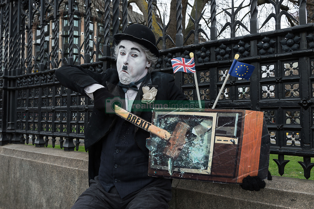March 27, 2019 - London, Greater London, United Kingdom - A pro-EU protester dressed as Charlie Chaplin demonstrates outside the Houses of Parliament in London. Today, MPs held a series of indicative votes on alternative Brexit plans following a government defeat in the Commons as parliamentarians took control of the order paper. (Credit Image: © Wiktor Szymanowicz/NurPhoto via ZUMA Press)