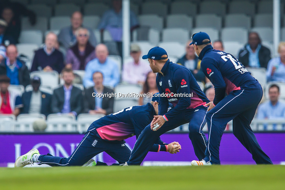 London,UK. 27 September 2017. Joe Root takes a catch watched by Jonny Bairstow (c) and Jason Roy (r) and Chris Gayle is out. England v West Indies. In the fourth Royal London One Day International at the Kia Oval.