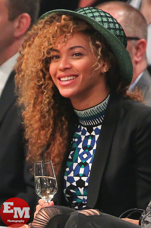 Apr 1, 2014; Brooklyn, NY, USA; Beyonce watches the action during the second quarter of the game between the Brooklyn Nets and the Houston Rockets at Barclays Center.