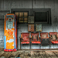 Retro gas station in USA with pump and chairs