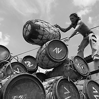 Indonesia, Jakarta,  Fisherman stacking buoys inside truck at Muara Angke market along waterfront