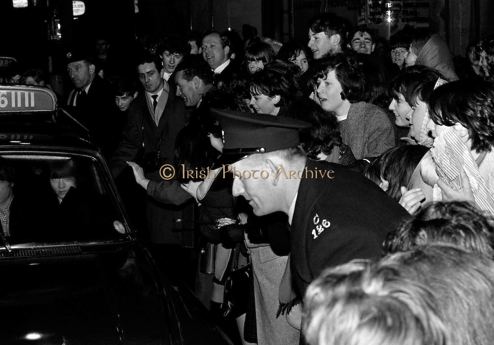 The Rolling Stones Charlie is my Darling - Ireland 1965..Rolling Stones fans catch a glimpse of the band during their visit to Dublin at the Adelphi Theatre, Middle Abbey Street Dublin. This was the band's first Irish tour of 1965....07/01/1965.01/07/1965.07 January 1965...The Rolling Stones Charlie is my Darling - Ireland 1965.Out November 2nd from ABKCO.Super Deluxe Box Set/Blu-ray and DVD Details Revealed. .ABKCO Films is proud to join in the celebration of the Rolling Stones 50th Anniversary by announcing exclusive details of the release of the legendary, but never before officially released film, The Rolling Stones Charlie is my Darling - Ireland 1965.  The film marked the cinematic debut of the band, and will be released in Super Deluxe Box Set, Blu-ray and DVD configurations on November 2nd (5th in UK & 6th in North America).. .The Rolling Stones Charlie is my Darling - Ireland 1965 was shot on a quick weekend tour of Ireland just weeks after ?(I Can't Get No) Satisfaction? hit # 1 on the charts and became the international anthem for an entire generation.  Charlie is my Darling is an intimate, behind-the-scenes diary of life on the road with the young Rolling Stones featuring the first professionally filmed concert performances of the band's long and storied touring career, documenting the early frenzy of their fans and the riots their live performances incited.. .Charlie is my Darling showcases dramatic concert footage - including electrifying performances of ?The Last Time,? ?Time Is On My Side? and the first ever concert performance of the Stones counterculture classic, ?(I Can't Get No) Satisfaction.?  Candid, off-the-cuff interviews are juxtaposed with revealing, comical scenes of the band goofing around with each other. It's also an insider's glimpse into the band's developing musical style by blending blues, R&B and rock-n-roll riffs, and the film captures the spark about to combust into The Greatest Rock and Roll Band in the World.. .The 1965 version