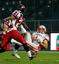 11.07.2011, UPC Arena, Graz, AUT, American Football WM 2011, Group B, Kanada (CAN) vs Oesterreich (AUT), im Bild Jakob Dieplinger (Austria, #1, WR) with the touchdown and Troy Adams (Canada, #21, DB) and Bryce McCall (Canada, #23, DB) coming too late// during the American Football World Championship 2011 Group B game, Canada vs Austria, at UPC Arena, Graz, 2011-07-11, EXPA Pictures © 2011, PhotoCredit: EXPA/ E. Scheriau