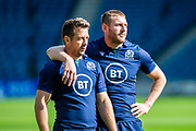 Scotland team mates Greg Laidlaw (left) and Finn Russell watch a passing drill during the Scotland Rugby training run ahead of their match against France at BT Murrayfield Stadium, Edinburgh, Scotland on 23 August 2019.