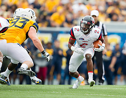Sep 12, 2015; Morgantown, WV, USA; Liberty Flames running back D.J. Abnar runs the ball against the West Virginia Mountaineers at Milan Puskar Stadium. Mandatory Credit: Ben Queen-USA TODAY Sports
