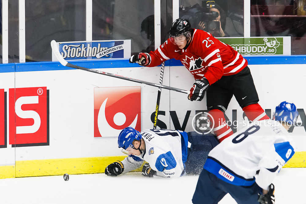 140104 Ishockey, JVM, Semifinal,  Kanada - Finland<br /> Icehockey, Junior World Cup, SF, Canada - Finland.<br /> Ville Pokka, (FIN) tackled by Josh Anderson, (CAN).<br /> Endast f&ouml;r redaktionellt bruk.<br /> Editorial use only.<br /> &copy; Daniel Malmberg/Jkpg sports photo